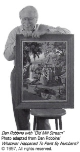 """Dan Robbins with his favorite Paint By Number design, """"Old Mill Stream,"""" painted by his mother."""