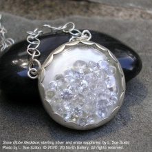 """Snow Globe Necklace,"" sterling silver and unmounted white sapphires by L. Sue Szabo. Photo by L. Sue Szabo"