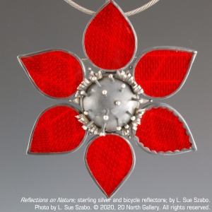 """""""Reflections on Nature,"""" sterling silver and bicycle reflectors, by L. Sue Szabo. Photo by L. Sue Szabo."""